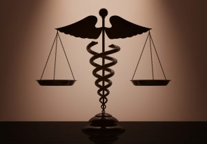Medical,Caduceus,Symbol,As,Scales,With,Backlight,Over,Wall,In