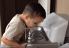 Child at school drinking fountain