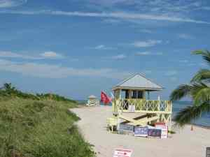The beach and lifeguard stand on the north end of Crandon Park Beach