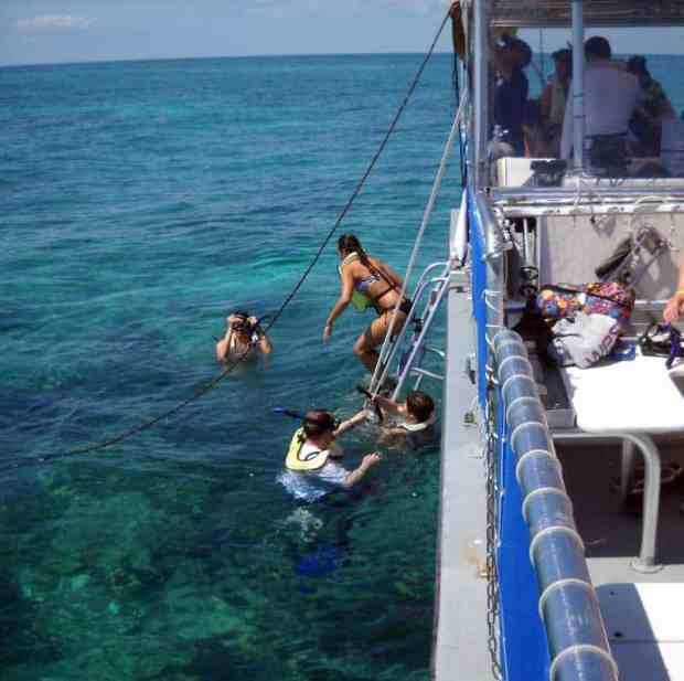 Snorkelers jump in at the Mandalay shipwreck at Biscayne National Park