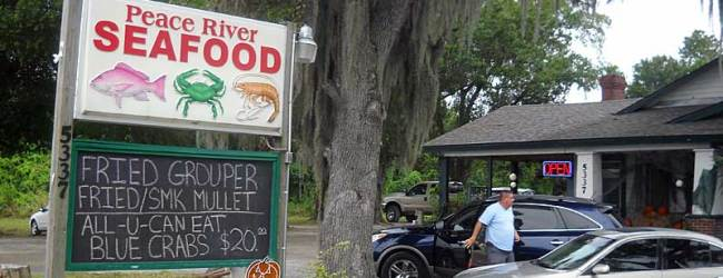 Peace River Seafood in Punta Gorda is located in a Cracker cabin under spreading oak trees.