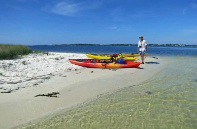 Clear water and a pristine beach await you on a kayak trip to Atsena Otie Key.