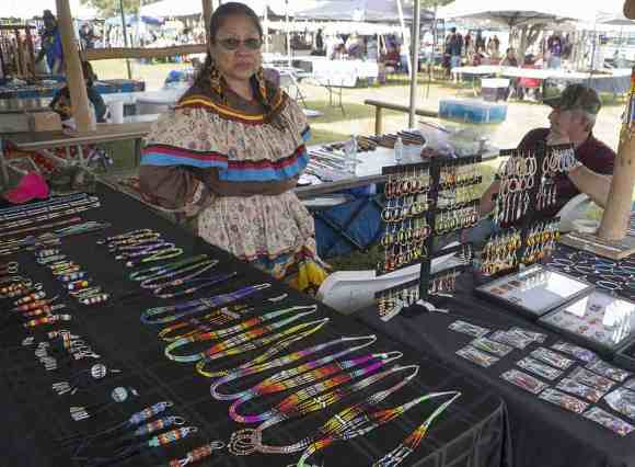 Native American vendors sells arts and traditional arts in the Indian market.