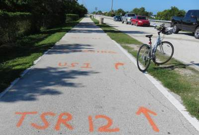 Crude signage tells you to cross U.S. 1 at the southern end of the Long Key Bridge on the Florida Keys Overseas Heritage Trail.