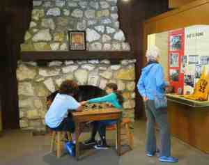 Inside the Civilian Conservation Corps Museum at Highland Hammocks State Park., the field-stone fireplace has a photo of FDR on the mantle.
