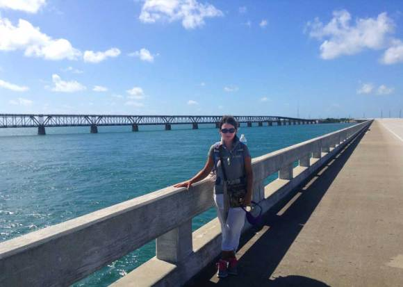Tamara Scharf on the Bahia Honda Bridge with the Old Bahia Honda Bridge in background. Photo courtesy Tamara Scharf.