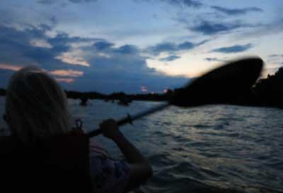 Kayaking on Mosquito Lagoon in Merritt Island National Wildlife Refuge as the sun sets. (Photo: David Blasco)