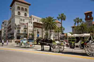 Carriages on King Street with Casa Monica in the background.