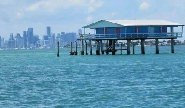The Jimmy Ellenburg House in Stiltsville with Miami skyline. (Photo: Bonnie Gross)