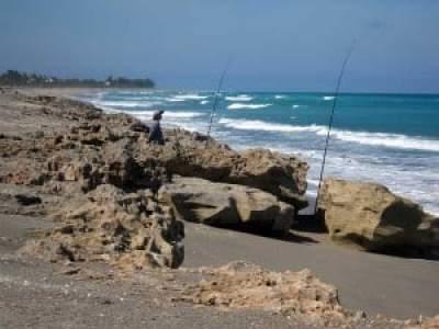 Fishermen at Blowing Rocks, Jupiter, Florida, beach