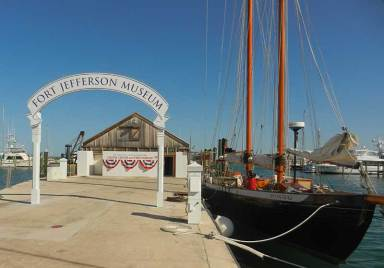 The Dry Tortugas and Key West Bight Interpretive Center is in the Key West Seaport. Docked next to it is the schooner Hindu.