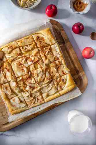 A Puff Pastry Apple Tart on a board