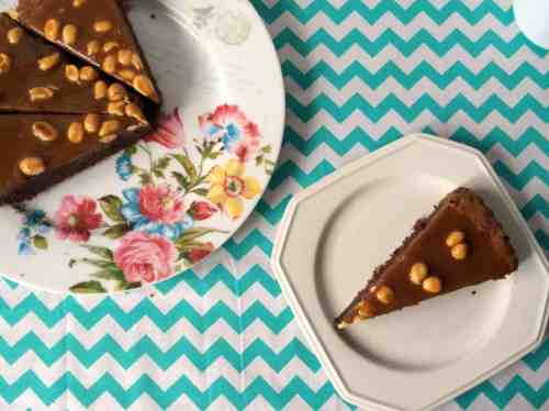 A Decadent Brownie Tart topped with Caramel Sauce & Peanuts