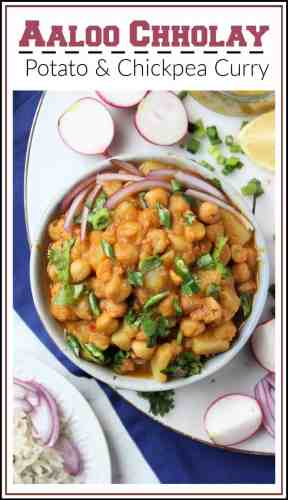A Pakistani recipe for a spiced potato and chickpea curry. A bowl of the curry with sliced onions, cilantro and green chilies.