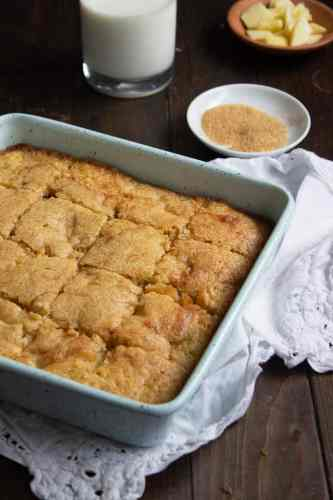 a pan of apple snack cake cut into squares