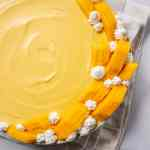 Easy Mango Mousse decorated with mangoes and whipped cream