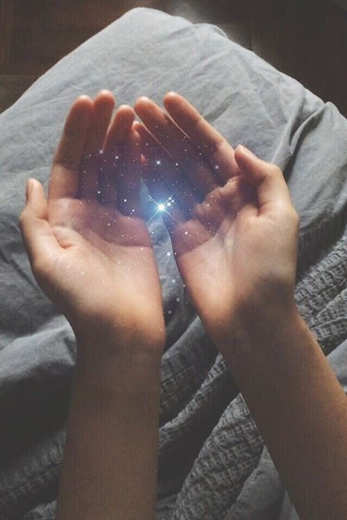 hands holding energy light stars