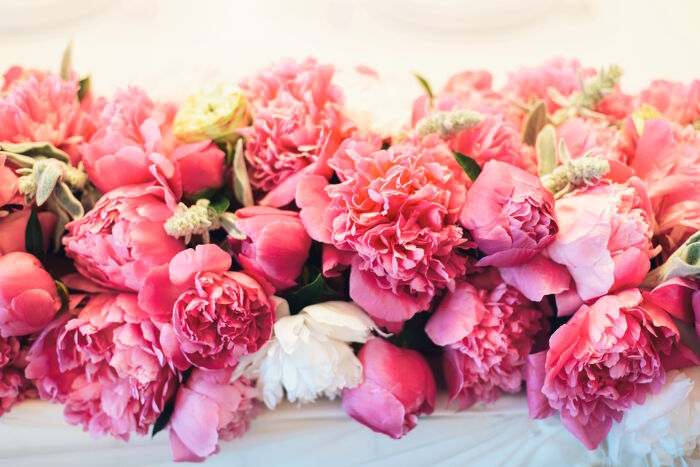 Peony Flower Meaning   Flower Meaning floral arrangement of pink peonies with leaves