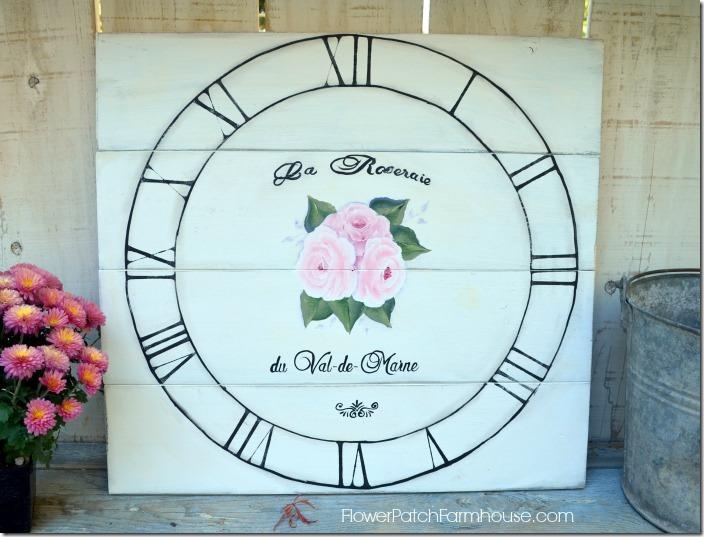 rose clock sign 700