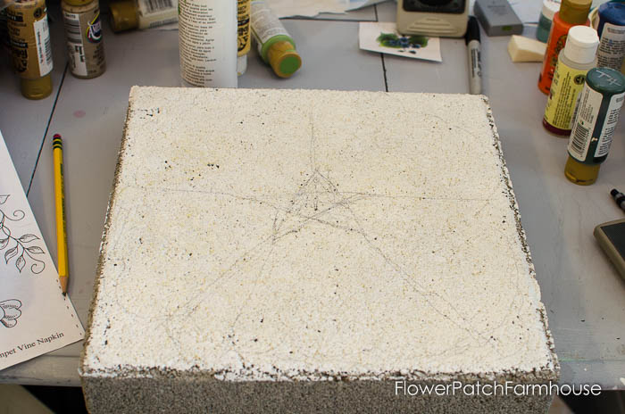 Paint a concrete stepping stone into a flower. Easy and an oh so fun way to dress up those drab pavers. FlowerPatchFarmhouse.com