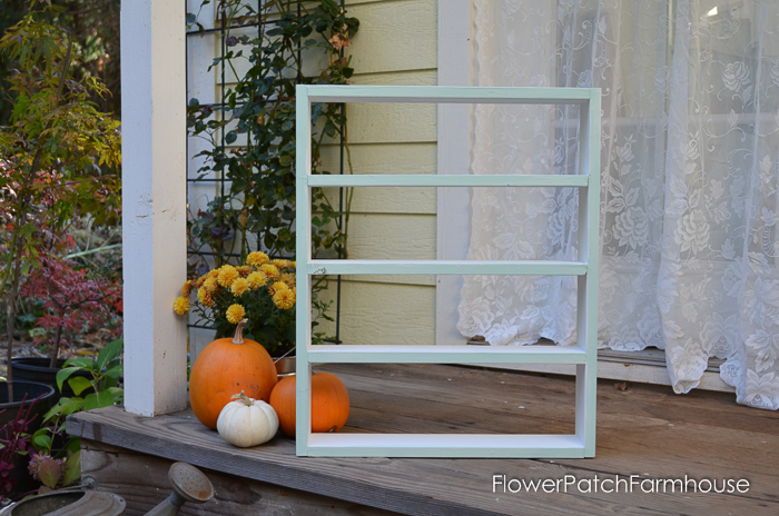 DIY cubby shelf for storing craft paint bottles in my studio, an easy project that is great for organizing my supplies. FlowerPatchFarmhouse.com