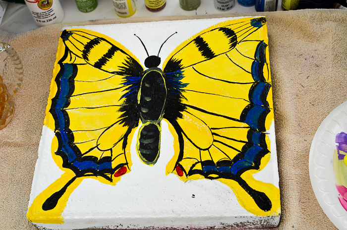 Paint a Swallowtail Butterfly on a plain cement paver to create a fabulous stepping stone. FlowerPatchFarmhouse.com