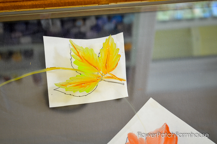 Paint Autumn Leaves on Glass. Gorgeous Fall colors arranged in a wreath in this painting tutorial. Step by step instructions and a video attached.