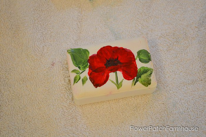 How to Paint Flowers on Bars of Soap. Great DIY gifts, decor and just plain fun! Create beautiful miniature paintings on soap with craft paints.