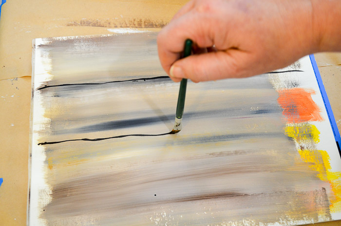 Draw board lines with the chisel edge of a flat brush.