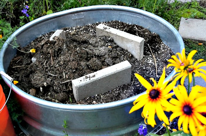 fire ring with concrete pavers, step by step to build a planter with solar fountain