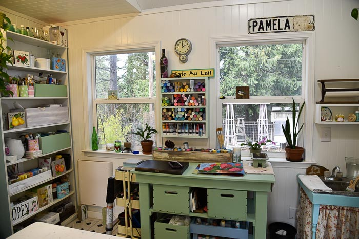 workbench and diy paint shelf in She Shed studio cottage