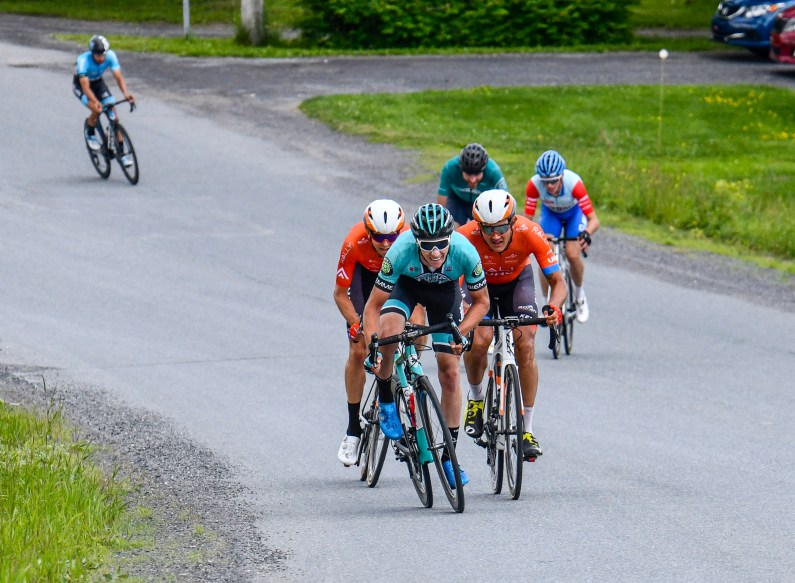 Nickolas Zukowsky tries to come over top of the two Rally riders on the run in to the finish ©canadiancyclist.com