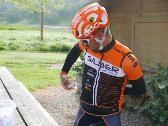 Emile loading up on Clif mini bars before a training ride