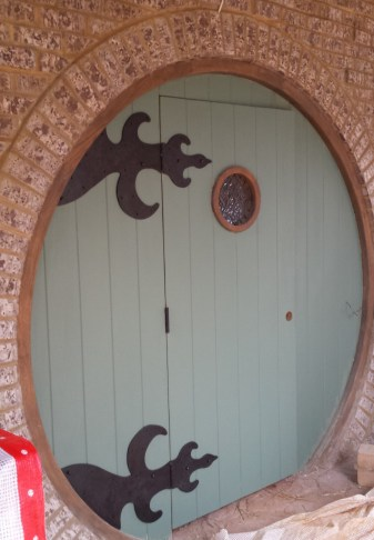 Hand-forged custom hinges for a custom hobbit door