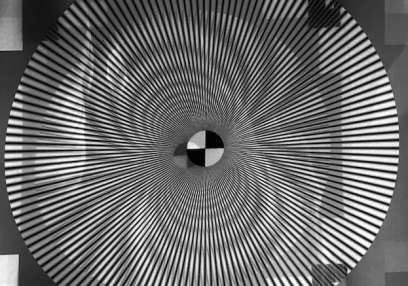 An optical illusion of a black and white striped, circular funnel that leads to a black and white checkered board.