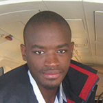 Peter Molapo In A Black Jacket