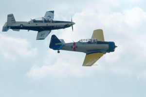An original T-6A Texan aircraft, right, flies with the new U.S. Air Force T-6 aircraft during the 2007 Randolph Air Force Base (AFB) Air Show at Randolph AFB, Texas, Nov. 4, 2007. (U.S. Air Force photo by Steve White/Released)