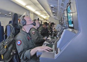 140316-N-XY761-019 INDIAN OCEAN (March 16, 2014) Crew members on board a P-8A Poseidon assigned to Patrol Squadron (VP) 16 man their workstations while assisting in search and rescue operations for Malaysia Airlines flight MH370. VP-16 is deployed in the U.S. 7th Fleet area of responsibility supporting security and stability in the Indo-Asia-Pacific. (U.S. Navy photo by Mass Communication Specialist 2nd Class Eric A. Pastor/Released