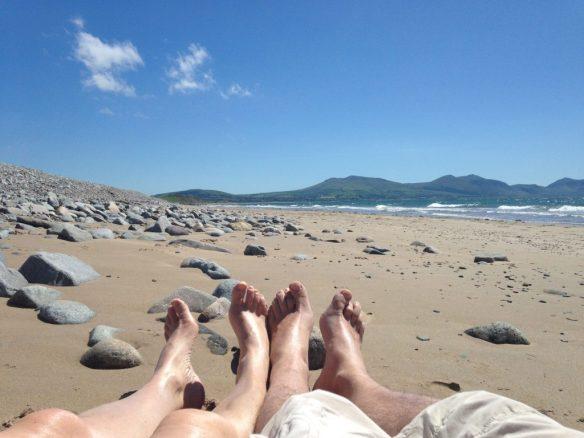 Feet on beach at Caernarfon