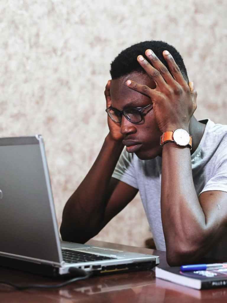 man working using a laptop