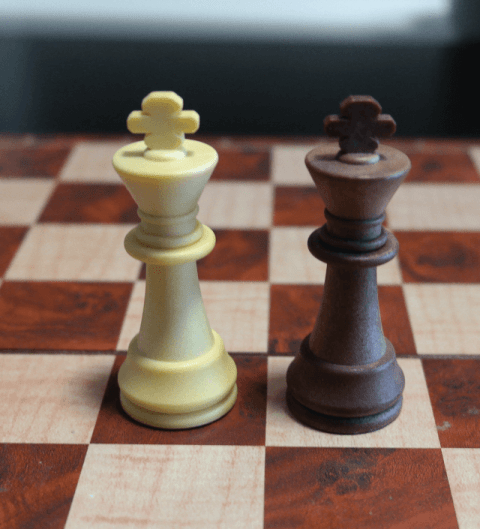 King Chess Pieces on a Chess Board