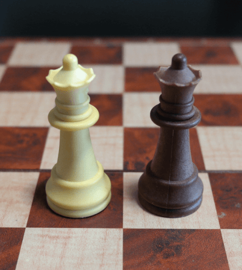 Queen Chess Pieces on a Chess Board