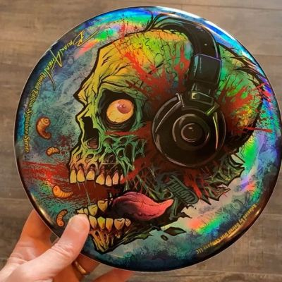 Just got my Foil Zombie discs from Detroit Disc Company, and I'm so thrilled how they came out. Special thanks for Discraft. Each of these 10 have my signature on them. Hand numbered, and shipped with a COA. Only 50 ever made. Shipping today! ONLY THREE LEFT, let me know if you want one. www.flylanddesigns.com/shop/#zombieart #discgolf #frisbeegolf #discraftdiscs #teamdiscraft #detroitdisccompany #disc