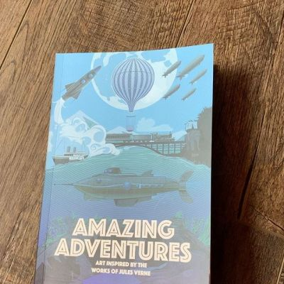 "Just received the ""Amazing Adventures"" art gallery book from Little Chimp Society featuring my Jules Verne Journey to the Center of the Earth artwork. So happy to have been apart of such a talented group!#julesverne #journeytothecenteroftheearth #posterart #posterartist #artbooks"