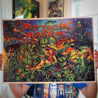 "I printed my Attack From Mars artwork as a batch of high-quality 14""X20"" art prints and posted them in my shop!These are limited editions of 100. Signed and numbered.Let me know if you'd like one!•••#attackfrommars #williams #bally #pinballart #pinballartwork #pinballexpo #pinball #pinballmachine #playfield #backglass #alienart #scifiart"