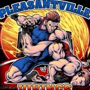 Two muscular wrestlers battling