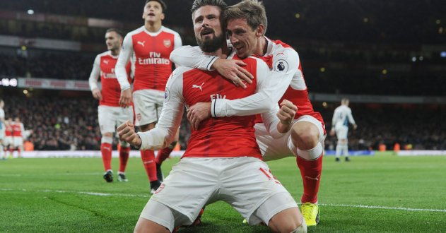 Olivier Giroud celebrates his winning goal against West Brom