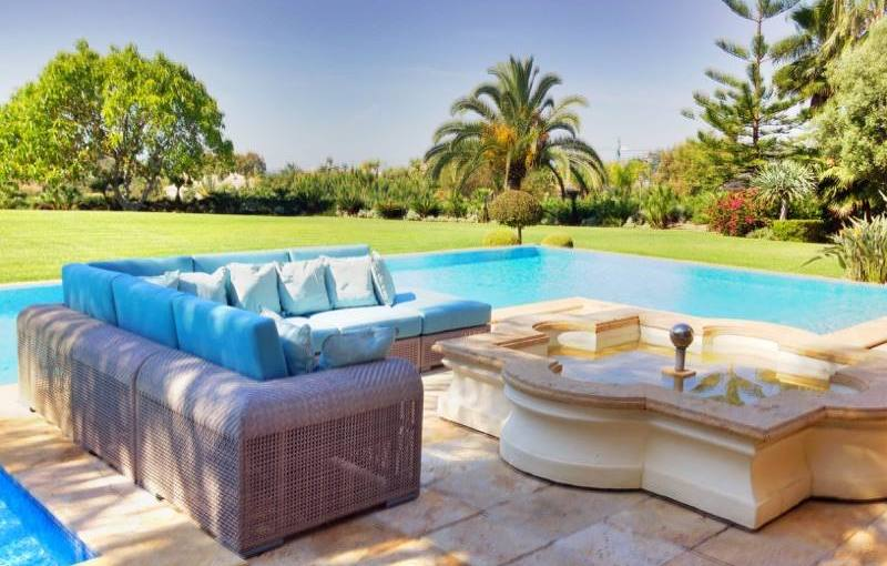 Outdoor cushions cut to size & shape and upholstered in Sunbrella Mineral Blue fabric.