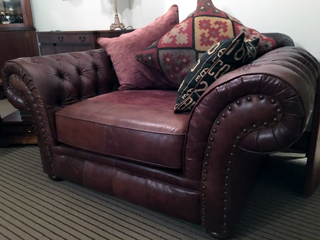 Image of a leather snuggle seat with leather cushion replacement.