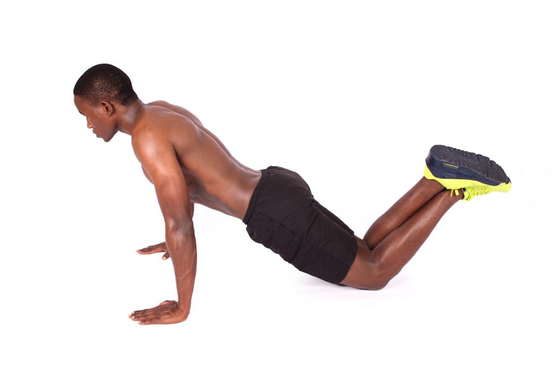 Shirtless Muscular Man Doing Knee Push Ups - High Quality Free Stock Images